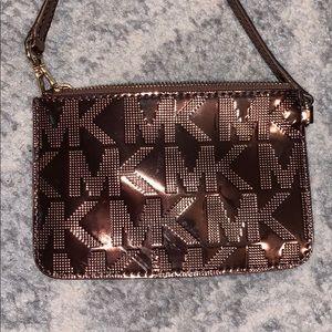 Authentic Michael Kors metallic wristlet